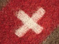 Mehr als das Rote Kreuz oder das Schweizer Symbol: universelles Zeichen christlicher Nächstenliebe.